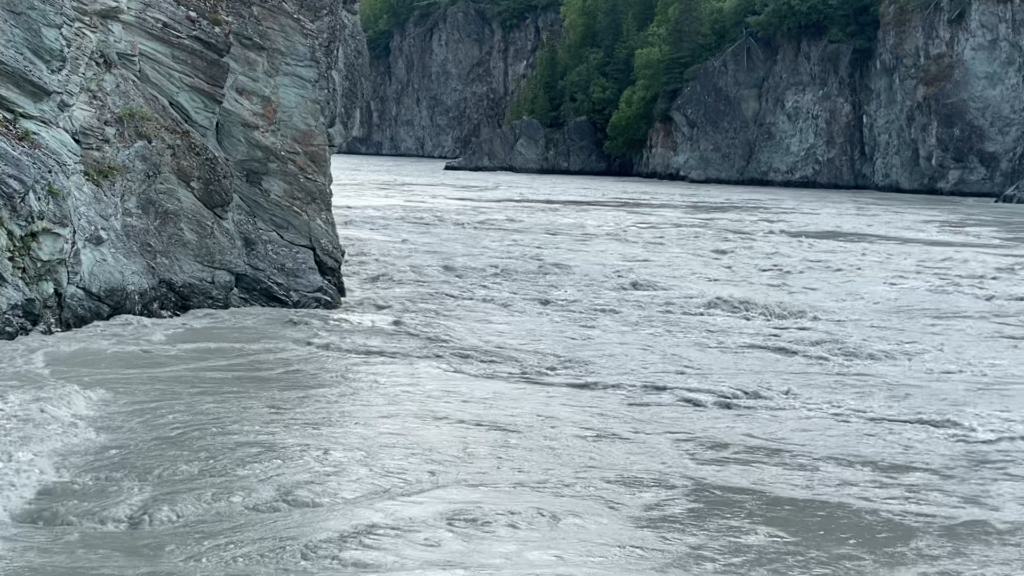 The Copper river canyon walls and turbulent glacial water forming dangerous under current.